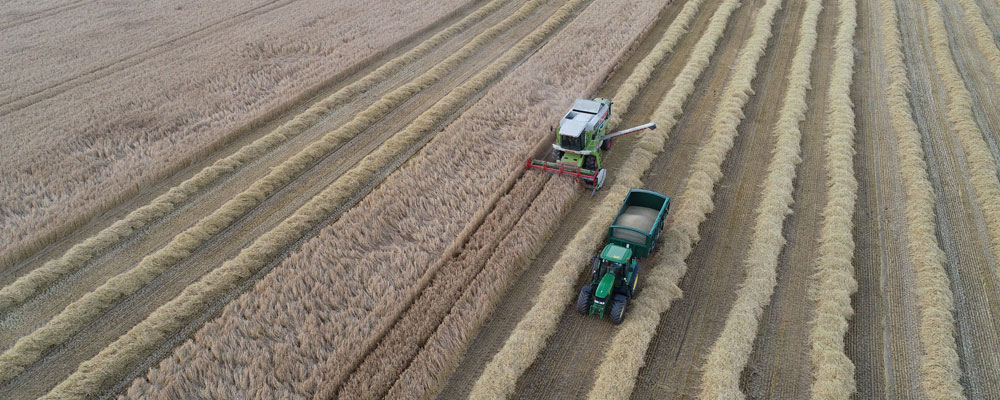 Drone video footage of farm vehicles