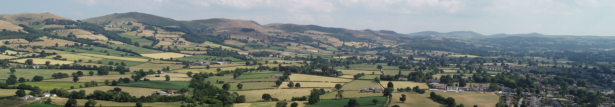 Aerial video of North Wales countryside and farm land